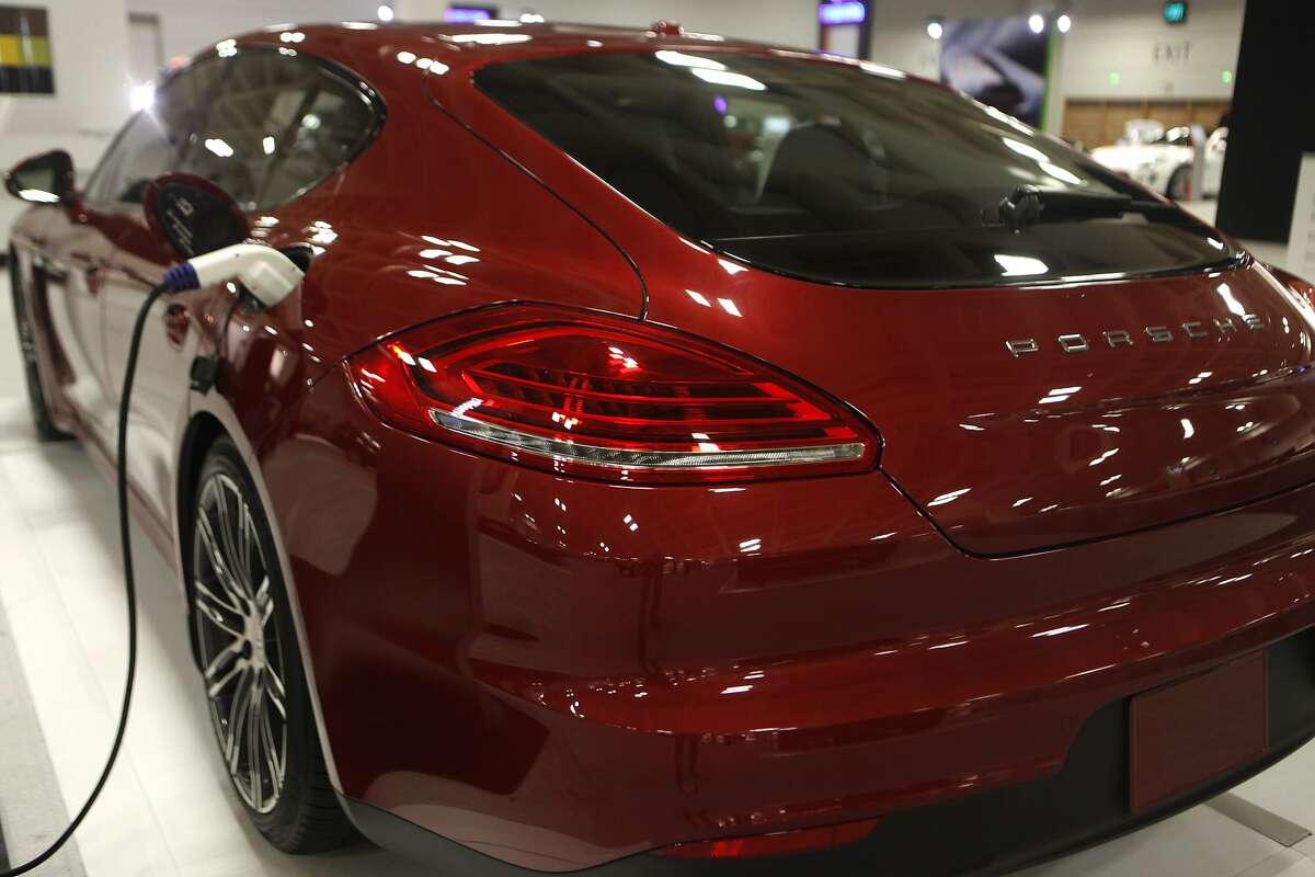 The charging port and rear end of a Electric Porsche at the SF Auto Show in the Moscone Center in San Francisco, Calif., on Friday November 21, 2014.