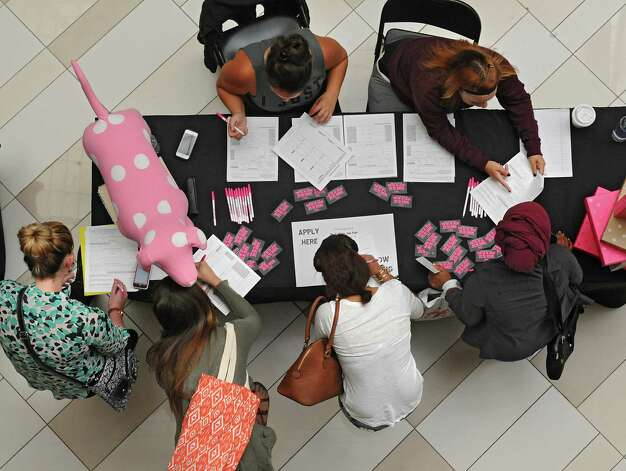 Job seekers fill out applications at the Victoria's Secret table during Crossgates Mall's job fair for the holiday shopping season on Wednesday, Sept. 10, 2014 in Guilderland N.Y. (Lori Van Buren / Times Union) Photo: Lori Van Buren / 00028548A