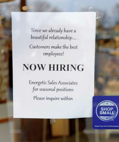 A sign hangs in the door of Pearl Grant Richmans advertising they are hiring for seasonal positions at Stuyvesant Plaza on Thursday, Nov. 20, 2014 in Guilderland, N.Y. (Lori Van Buren / Times Union) Photo: Lori Van Buren / 00029581A