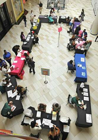 Job seekers fill out applications during Crossgates Mall's job fair for the holiday shopping season on Wednesday, Sept. 10, 2014 in Guilderland N.Y. (Lori Van Buren / Times Union) Photo: Lori Van Buren / 00028548A