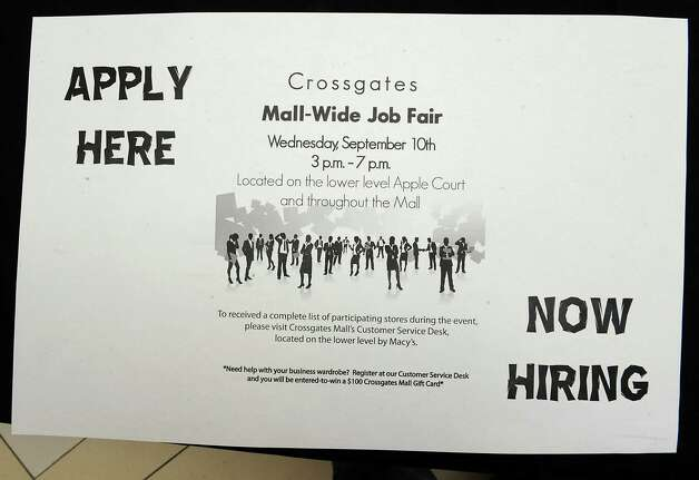 A sign for Crossgates Mall's job fair for the holiday shopping season is seen on a table Wednesday, Sept. 10, 2014 in Guilderland N.Y. (Lori Van Buren / Times Union) Photo: Lori Van Buren / 00028548A