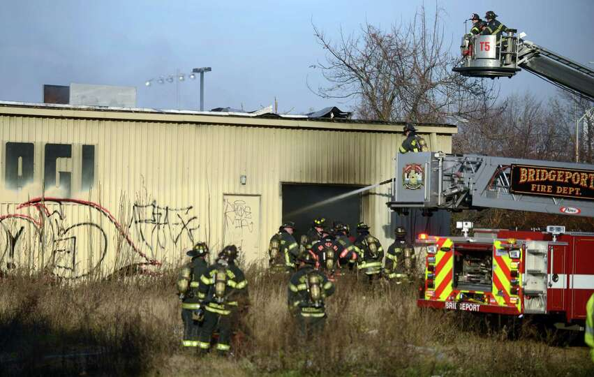 Firefighters work to put out a fire at 144 Stratford Avenue inside the abandoned AGI Rubber Co. Satu