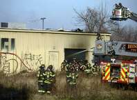 Firefighters work to put out a fire at 144 Stratford Avenue inside the abandoned AGI Rubber Co. Saturday, Nov. 22, 2014 in Bridgeport, Conn.