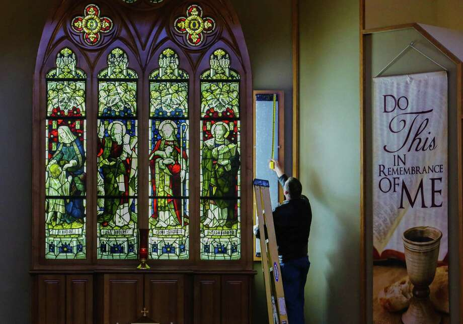 Andrew Mann takes a quick measurement of the stained