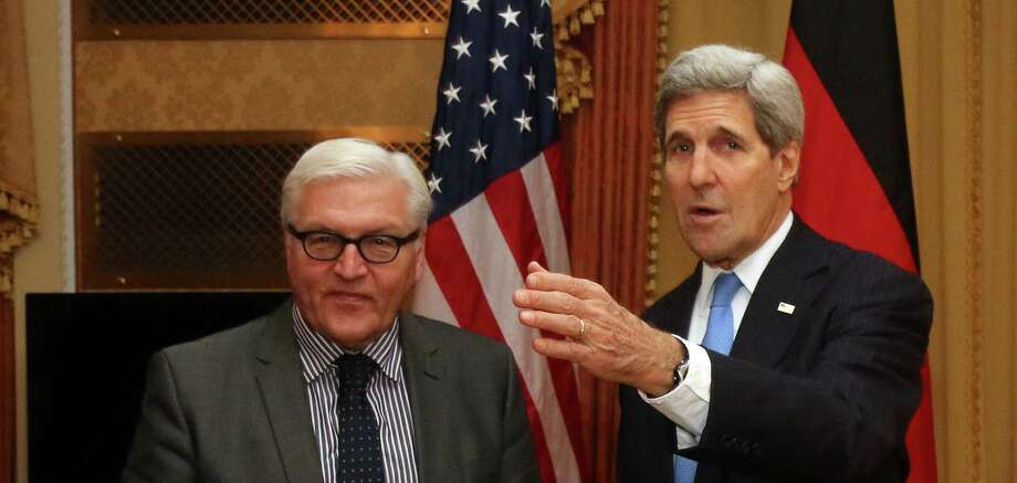 """German Foreign Minister Frank-Walter Steinmeier , left,  looks on  as U.S. Secretary of State John Kerry, speaks during closed-door nuclear talks with Iran in Vienna, Saturday, Nov. 22, 2014. Iran and six world powers have """"never been closer"""" to agreement on a nuclear deal since they started negotiating more than six years ago, but it is up to Tehran to close the gap, Germany's foreign minister said Saturday. High-level comings and goings since Friday also have seen British Foreign Secretary Philip Hammond and French Foreign Minister Laurent Fabius stop by for talks with Kerry, Iranian Foreign Minister Mohammad Javad Zarif  and other participants in the negotiations.  (AP Photo/Ronald Zak) Photo: Ronald Zak, STR / AP"""