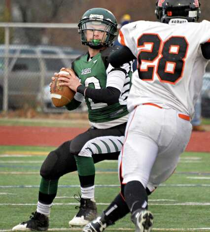 Schalmont back-up quarterback #12 Anthony Yezzo, left, looks for a reciever during the Class B semifinal against Marlboro at Dietz Stadium Saturday Nov. 22, 2014, in Kingston, NY.  (John Carl D'Annibale / Times Union) Photo: John Carl D'Annibale / 00029582A