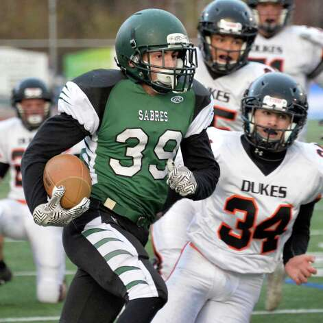Schalmont's #39 Hunter Gac gains ground during the Class B semifinal against Marlboro at Dietz Stadium Saturday Nov. 22, 2014, in Kingston, NY.  (John Carl D'Annibale / Times Union) Photo: John Carl D'Annibale / 00029582A