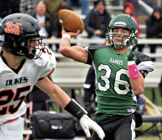 Schalmont QB Nick Gallo fires off a touchdown pass to Dalton Cooke during the Class B semifinal against Marlboro at Dietz Stadium Saturday Nov. 22, 2014, in Kingston, NY.  (John Carl D'Annibale / Times Union) Photo: John Carl D'Annibale / 00029582A