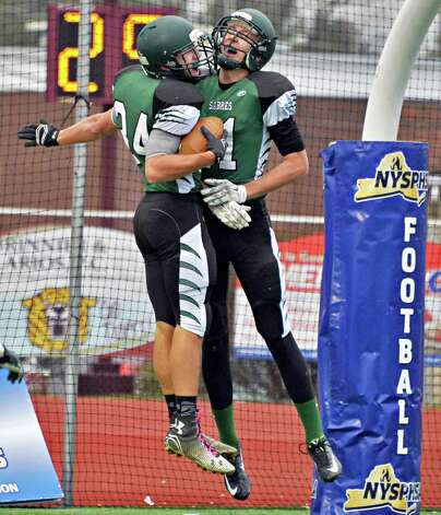 Schalmont 's #34 Dalton Cooke, left, and #11 Zac O'Dell celebrate Cooke's TD during the Class B semifinal against Marlboro at Dietz Stadium Saturday Nov. 22, 2014, in Kingston, NY.  (John Carl D'Annibale / Times Union) Photo: John Carl D'Annibale / 00029582A