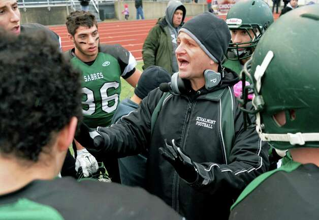 Schalmont head coach Joe Whipple, center, with players during a time out in the Class B semifinal against Marlboro at Dietz Stadium Saturday Nov. 22, 2014, in Kingston, NY.  (John Carl D'Annibale / Times Union) Photo: John Carl D'Annibale / 00029582A