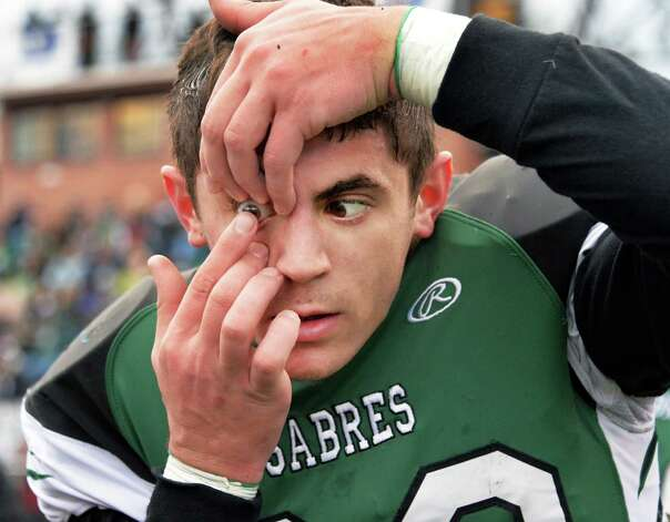 Schalmont's #39 Hunter Gac replaces a contact lens on the sidelines during the Class B semifinal against Marlboro at Dietz Stadium Saturday Nov. 22, 2014, in Kingston, NY.  (John Carl D'Annibale / Times Union) Photo: John Carl D'Annibale / 00029582A