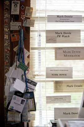 """Journalist Mark Dowies collection of press credentials on display at his home office in Inverness, California, on November 21, 2014. Since the 1980s, Dowie has helped three terminally ill friends """"die with dignity"""" and he currently advocates for state lawmakers to clarify California's ambiguous right-to-die laws."""