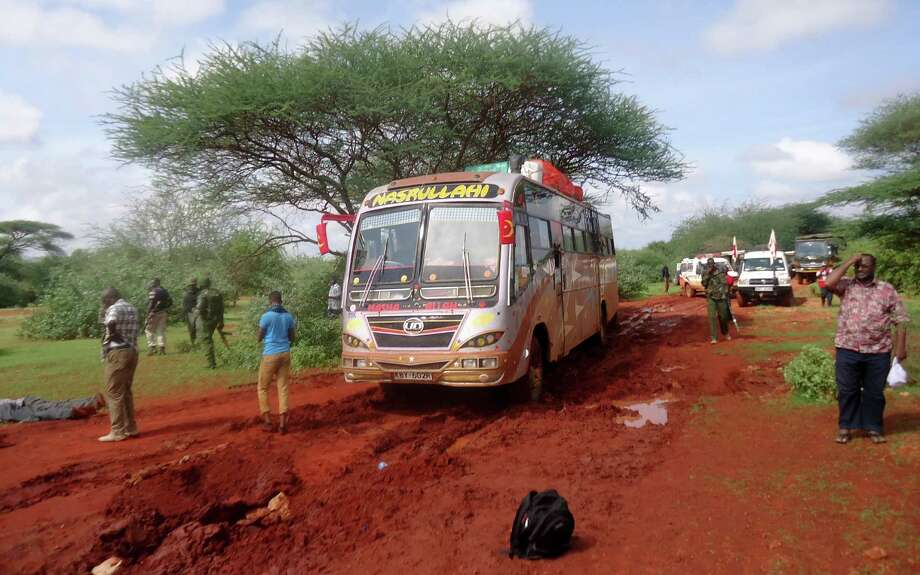 Kenyan security forces and others gather Saturday after an al-Shabab attack on a bus about 31 miles outside the town of Mandera, near the Somali border. One survivor described a massacre of passengers.  Photo: STR / AP
