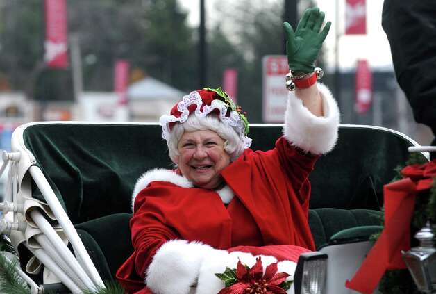 Joanne McGraw of Saratoga dressed as Mrs. Claus takes a horse-drawn carriage ride during the Stuyvesant Plaza open house on Saturday Nov. 22, 2014 in Guilderland, N.Y. (Michael P. Farrell/Times Union) Photo: Michael P. Farrell / 00029594A