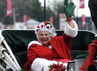 Joanne McGraw of Saratoga dressed as Mrs. Claus takes a horse-drawn carriage ride during the Stuyvesant Plaza open house on Saturday Nov. 22, 2014 in Guilderland, N.Y. (Michael P. Farrell/Times Union)