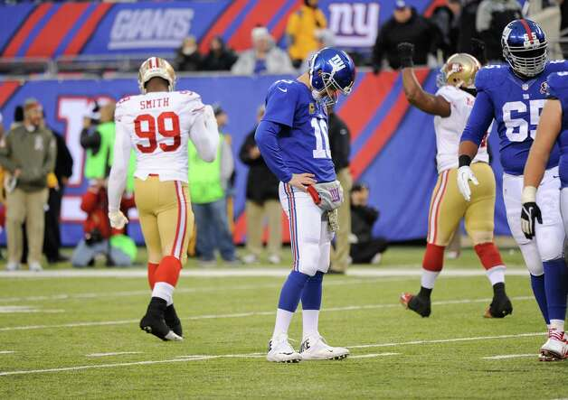 New York Giants quarterback Eli Manning (10) reacts after failing to score on fourth down during the second half of an NFL football game against the San Francisco 49ers, Sunday, Nov. 16, 2014, in East Rutherford, N.J.  (AP Photo/Bill Kostroun) ORG XMIT: ERU135 Photo: Bill Kostroun / FR51951 AP