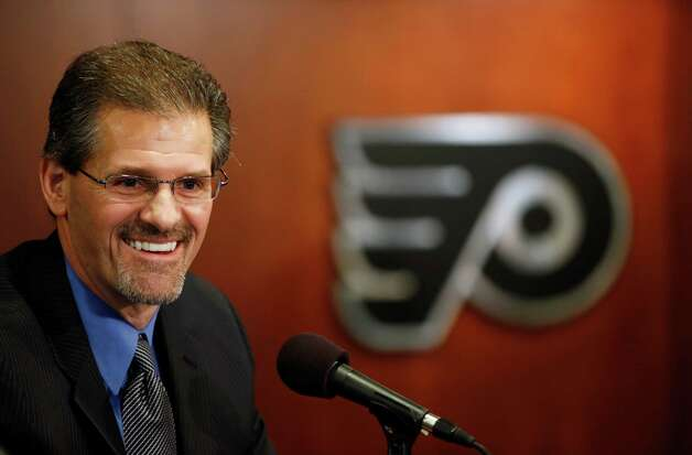 FILE - In this May 7, 2014, file photo, New Philadelphia Flyers general manager Ron Hextall speaks during an NHL hockey news conference in Philadelphia. Far removed from punishing hits on the ice, the real crunching in the NHL these days is being done in front offices around the league with the numbers involved in the complex, lengthy calculations of analytics. It's a new era in the NHL and — much like in baseball — there's a still a divide between the new school thinkers and the hockey lifers stewing at the thought that newfangled stats could ever replace gut feel in building a Stanley Cup championship roster. (AP Photo/Matt Slocum, File) ORG XMIT: NY163 Photo: Matt Slocum / AP