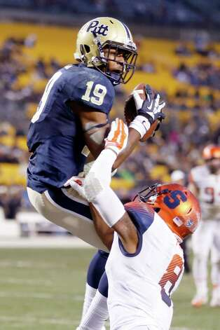 Pittsburgh wide receiver Dontez Ford (19) makes a touchdown catch over Syracuse safety Darius Kelly (8) in the second quarter of an NCA college football game, Saturday, Nov. 22, 2014, in Pittsburgh. (AP Photo/Keith Srakocic) ORG XMIT: PAKS104 Photo: Keith Srakocic / AP