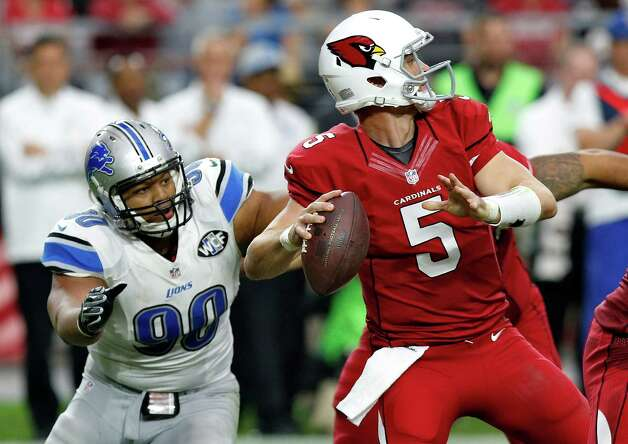 Arizona Cardinals quarterback Drew Stanton looks to pass under pressure from Detroit Lions defensive tackle Ndamukong Suh (90) during the first half of an NFL football game, Sunday, Nov. 16, 2014, in Glendale, Ariz. (AP Photo/Ross D. Franklin)  ORG XMIT: AZMY120 Photo: Ross D. Franklin / AP