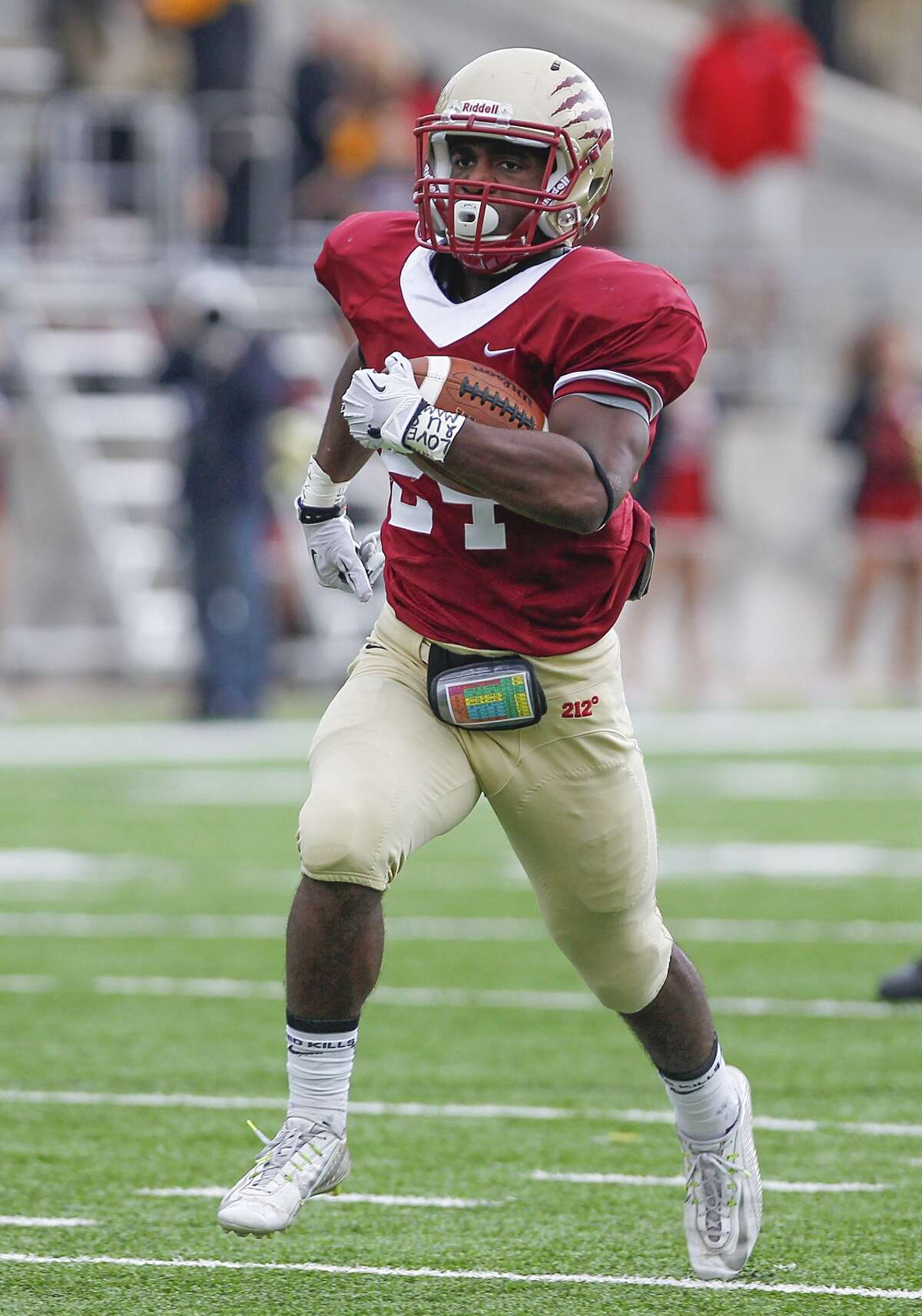 RJ Harmon of Cy Woods rushes for a Wildcat touchdown as they hosted Katy Taylor in the 6A Region III Playoffs at the Berry Center on November 22, 2014.