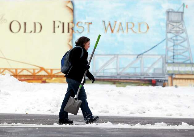 Beth Bragg carries a shovel to the Old First Ward Community Center on Saturday, Nov. 22, 2014, in Buffalo, N.Y. Volunteers registered at the center and fanned out to the hardest hit areas of Buffalo to help clear snow after this week's heavy lake-effect snowstorms. (AP Photo/Mike Groll) ORG XMIT: NYMG101 Photo: Mike Groll / AP