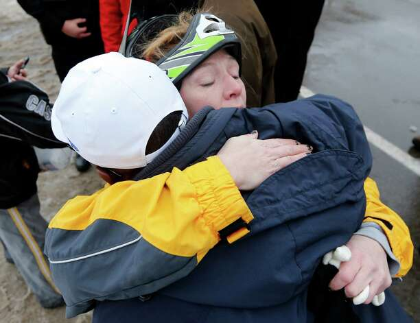 Nichole Kepple hugs Buffalo Mayor Byron Brown thanking him for efforts to clear south Buffalo streets on Saturday, Nov. 22, 2014, in Buffalo, N.Y. Western New York continues to dig out from the heavy snow dropped by this week by lake-effect snowstorms. (AP Photo/Mike Groll) ORG XMIT: NYMG107 Photo: Mike Groll / AP