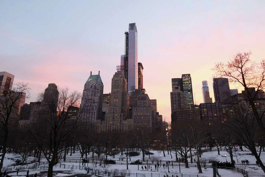One57, center, and other skyscrapers along 57th Street, seen from Central Park at dusk in New York, Dec. 19, 2013. The building developer, Extell Development, lobbied for a specific bill in the state Senate in 2012 that would have amended real property tax laws in New York City. Extell donated $300,000 to the Cuomo campaign. Extell donated $300,000 to the Cuomo campaign. (Hiroko Masuike/The New York Times) Photo: HIROKO MASUIKE / NYTNS