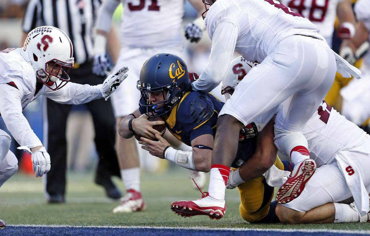 California's Luke Rubenzer is tackled short of the goal line in 3rd quarter of Stanford's 38-17 win during NCAA football game at Cal Memorial Stadium in Berkeley, Calif., on Saturday, November 22, 2014. The play was originally ruled a touchdown but was overturned.
