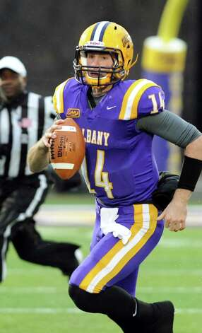 UAlbany's quarterback Will Fiacchi carries the ball during their football game against Stony Brook on Saturday, Nov. 22, 2014, at Bob Ford Field in Albany, N.Y. (Cindy Schultz / Times Union) Photo: Cindy Schultz / 00029589A