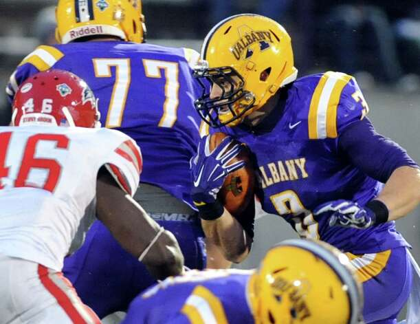 UAlbany's Jake Meek, right, carries the ball during their football game against Stony Brook  on Saturday, Nov. 22, 2014, at Bob Ford Field in Albany, N.Y. (Cindy Schultz / Times Union) Photo: Cindy Schultz / 00029589A
