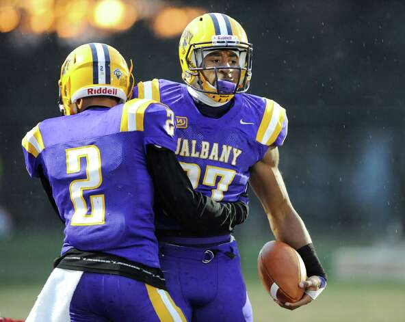 UAlbany's Cameron Lewis, right, celebrates a touchdown with Josh Gontarek during their football game against Stony Brook  on Saturday, Nov. 22, 2014, at Bob Ford Field in Albany, N.Y. (Cindy Schultz / Times Union) Photo: Cindy Schultz / 00029589A