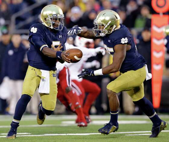 Notre Dame quarterback Everett Golson (5) hands off the ball to running back Tarean Folston, right, during the first half of an NCAA college football game against Louisville in South Bend, Ind., Saturday, Nov. 22, 2014. (AP Photo/Nam Y. Huh) ORG XMIT: INNH105 Photo: Nam Y. Huh / AP