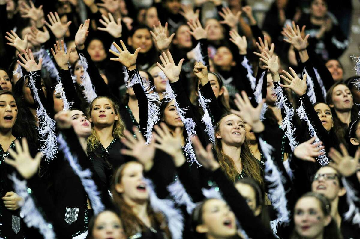 Reagan's dancers cheer during their alma mater during their game where the Rattlers defeated the Stevens Falcons 38-31 during the class 6A Division 1 second-round high school football game at the Alamodome on Saturday, November 22, 2014.