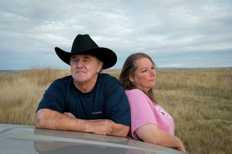 Andrew Rohr, who was badly burned in a oil rig blowout in 2011, with his wife, Winnie, near their home in Marmath, N.D. Continental Resources blamed Rohr and his crew for the accident. Photo: RICH ADDICKS, STR / NYTNS