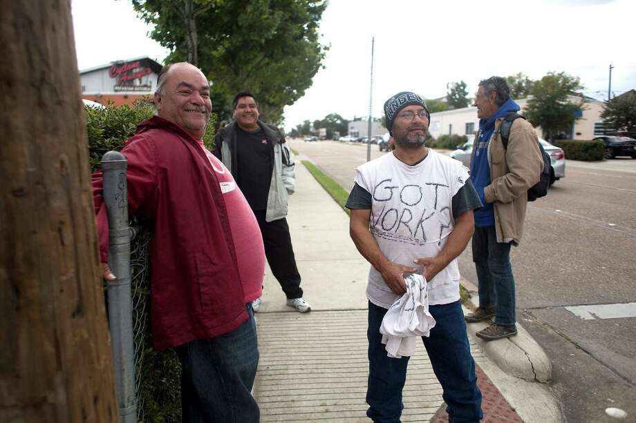 """Carlos, 54, left, from Honduras, a day laborer who has lived in the U.S. illegally for the past 20 years, waits for work on the corner of Durham and Nolda last week. He said having the ability to obtain work legally would benefit him. """"It would help millions of us step out of the shadows. We are living by faith,"""" he said. """"I don't want to be an illegal alien."""" Photo: Johnny Hanson, Staff / © 2014  Houston Chronicle"""