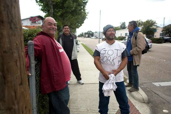 "Carlos, 54, left, from Honduras, a day laborer who has lived in the U.S. illegally for the past 20 years, waits for work on the corner of Durham and Nolda last week. He said having the ability to obtain work legally would benefit him. ""It would help millions of us step out of the shadows. We are living by faith,"" he said. ""I don't want to be an illegal alien."""