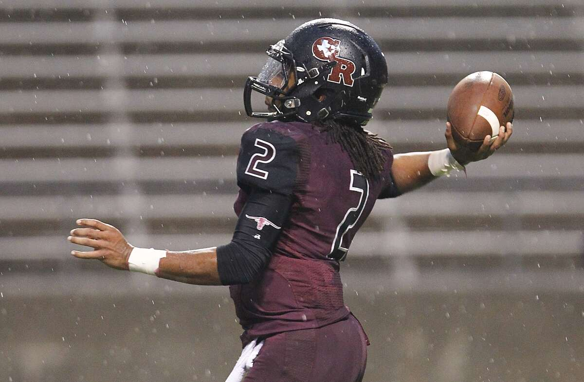 George Ranch quarterback Timon Nolan fires off a pass as the Longhorns hosted Kingwood Park in the 5A Region III Playoffs at the Berry Center on November 22, 2014.