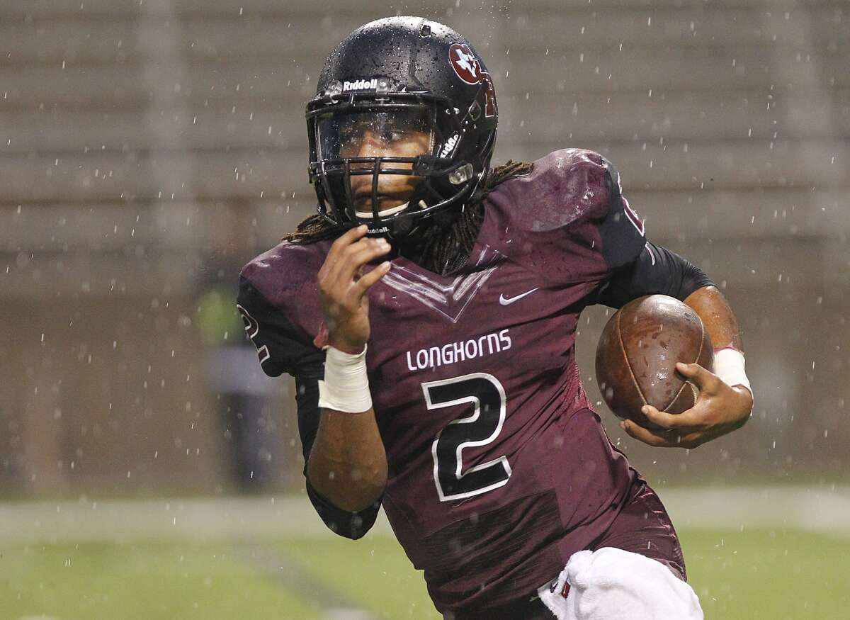 George Ranch quarterback Timon Nolan looks for daylight on the quarterback keep as the Longhorns hosted Kingwood Park in the 5A Region III Playoffs at the Berry Center on November 22, 2014.