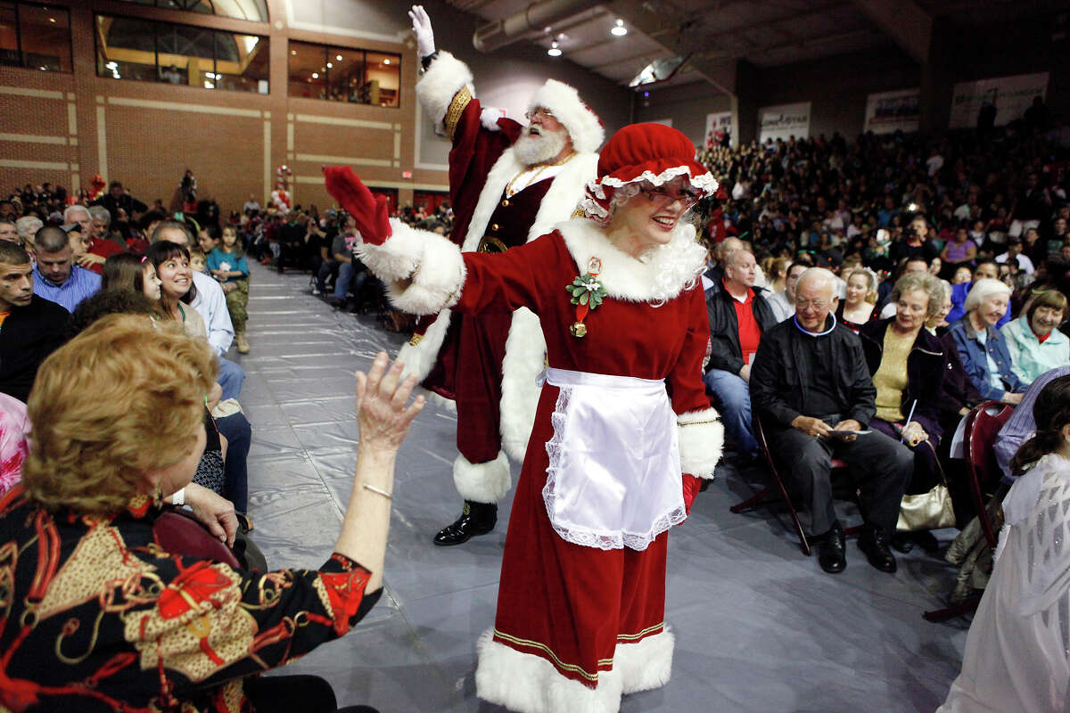Santa Claus and Mrs. Claus enter the McDermott Convocation Center for the 28th Annual Light the Way event at the University of the Incarnate Word Saturday Nov. 22, 2014. The event was held indoors due to the weather and filled to capacity at 3000 people. The event ended with turning on over a million lights around the UIW campus.