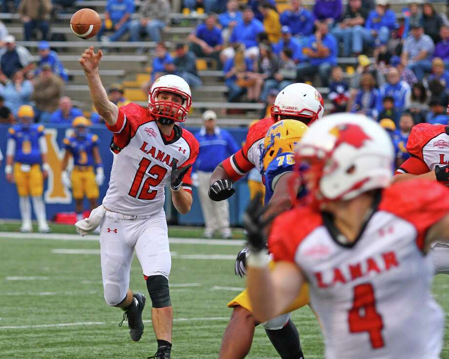 Caleb Berry passes the ball to Jayce Nelson during the first half of the game between the Lamar Cardinals and the McNeese State University Cowboys at Cowboy Stadium in Lake Charles, LA, November 22, 2014 (photo provided by Kyle Ezell).