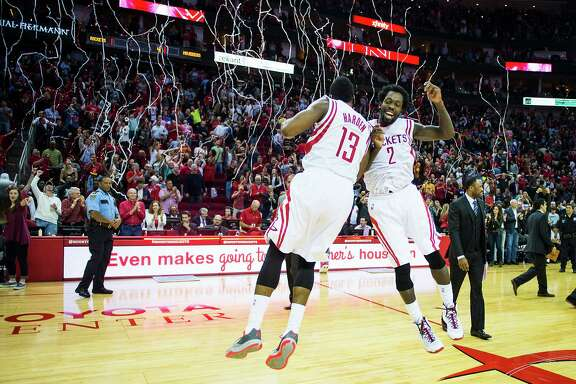 Rockets guards James Harden (13) and Pat Beverley jumped for joy amid the streamers after they helped clinch a 95-92 victory over Dallas on Saturday at Toyota Center. The two combined for 52 points, with Harden scoring a game-high 32.