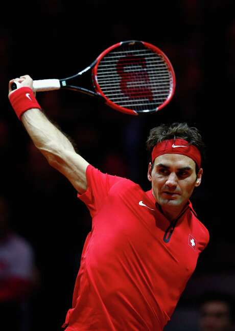 LILLE, FRANCE - NOVEMBER 21:  Roger Federer of Switzerland in action against Gael Monfils of France during day one of the Davis Cup Tennis Final between France and Switzerland at the Stade Pierre Mauroy on November 21, 2014 in Lille, France.  (Photo by Julian Finney/Getty Images) Photo: Julian Finney, Staff / 2014 Getty Images