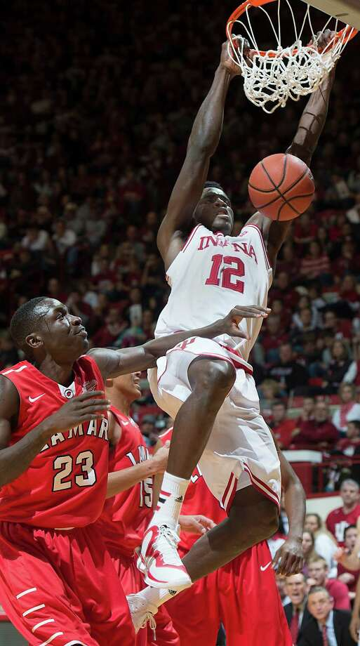 Indiana's Hanner Mosquera-Perea slams the ball in front of Lamar's Dontavious Sears during an NCAA college basketball game in Bloomington, Ind., Saturday, Nov. 22, 2014. Indiana won 85-72. (AP Photo/Bloomington Herald-Times, David Snodgress) Photo: David Snodgress, MBR / Bloomington Herald-Times