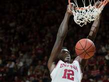 Indiana's Hanner Mosquera-Perea slams the ball in front of Lamar's Dontavious Sears during an NCAA college basketball game in Bloomington, Ind., Saturday, Nov. 22, 2014. Indiana won 85-72. (AP Photo/Bloomington Herald-Times, David Snodgress)
