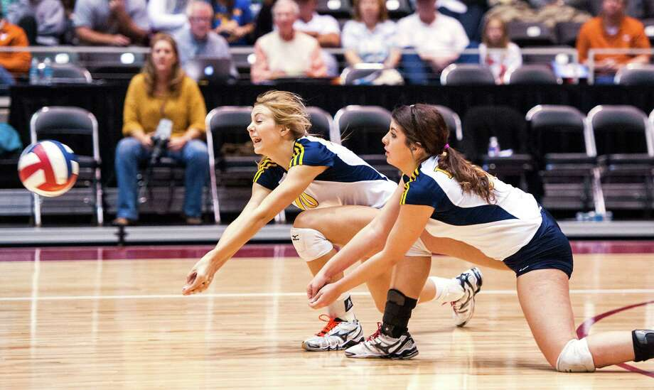 Poth's Alyssa Kallies (10) and Madison Caloss (30) during their UIL Class 3A state championship volleyball match against Brock on Sat., Nov. 22, 2014 at the Curtis Cullwell Center in Garland, TX. Photo: Ashley Landis / Ashley Landis / For The Express-News / ***NOT FOR RESALE***