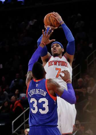 New York Knicks' Carmelo Anthony (7) shoots over Philadelphia 76ers' Robert Covington (33) during the second half of an NBA basketball game Saturday, Nov. 22, 2014, in New York. The Knicks won the game 91-83. (AP Photo/Frank Franklin II) ORG XMIT: MSG112 Photo: Frank Franklin II / AP