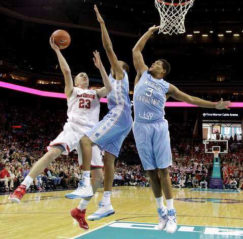 Davidson's Peyton Aldridge, left, shoots over North Carolina's Brice Johnson, center, and Kennedy Meeks, right, during the first half of an NCAA college basketball game in Charlotte, N.C., Saturday, Nov. 22, 2014. (AP Photo/Chuck Burton) ORG XMIT: NCCB105 Photo: Chuck Burton / AP
