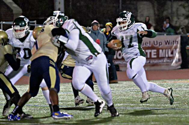 Shen's #37 Oliver Robinson, right, carries the ball during their Class AA state semifinals against Newburgh Free Academy at Dietz Stadium Friday Nov. 22, 2014, in Kingston, NY.  (John Carl D'Annibale / Times Union) Photo: John Carl D'Annibale / 00029583A