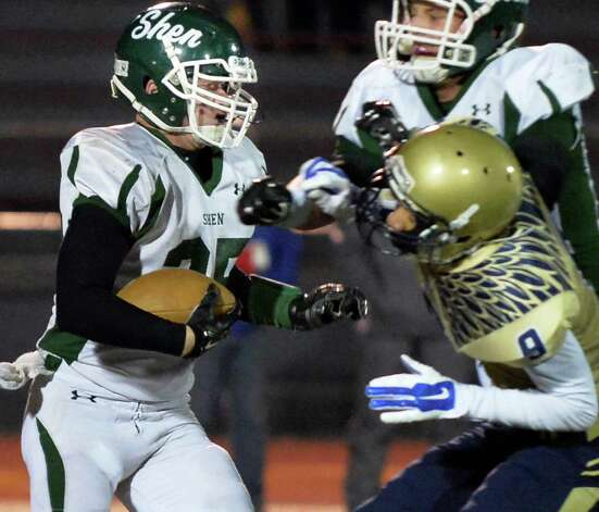 Shen's #25 Matt Taft, left, blasts through Newburgh Free Academy defenders during the Class AA state semifinals at Dietz Stadium Friday Nov. 22, 2014, in Kingston, NY.  (John Carl D'Annibale / Times Union) Photo: John Carl D'Annibale / 00029583A
