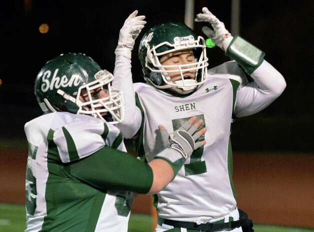 Shen's #85 Erik Kromer, left, congratulates team mate #7 Brendan Marra after his touch down during the Class AA state semifinals against Newburgh Free Academy at Dietz Stadium Friday Nov. 22, 2014, in Kingston, NY.  (John Carl D'Annibale / Times Union) Photo: John Carl D'Annibale / 00029583A